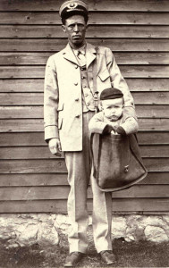 Uniformed_Letter_Carrier_with_Child_in_Mailbag